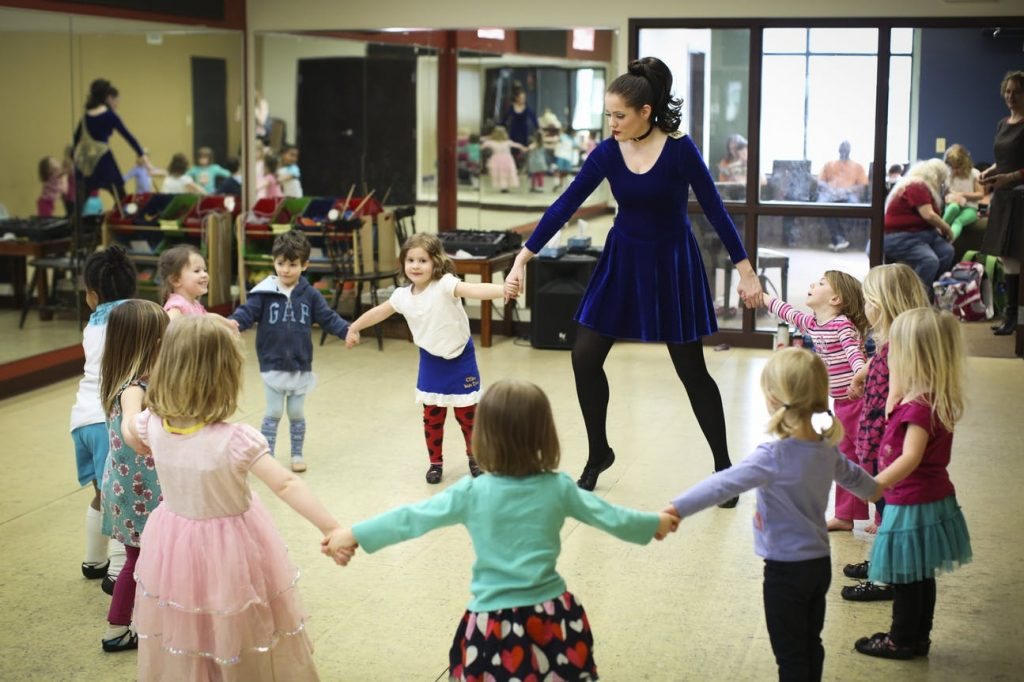 Mikayla Newby held some children's hands as they danced in a circle during a beginning Irish dance class at O'Shea Irish Dance at Celtic Junction in St. Paul,