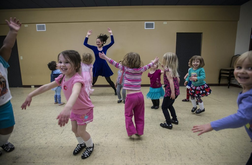 Mikayla Newby jumped with a group of children during a beginning Irish dance class at O'Shea Irish Dance at Celtic Junction in St. Paul, Minn., on Thursday, March 12, 2015.