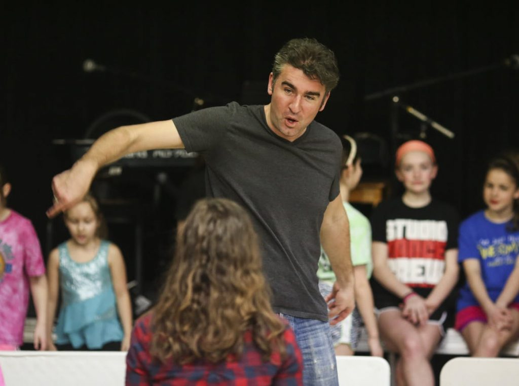 Cormac O'Shea instructs a group of dancers .