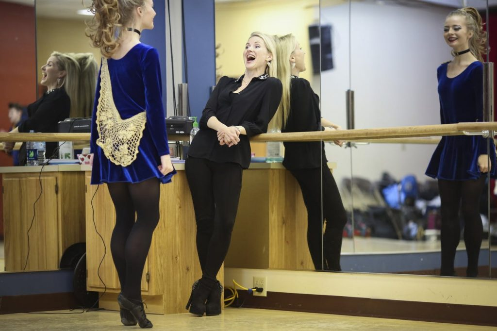Natalie O'Shea laughs with a dancer .