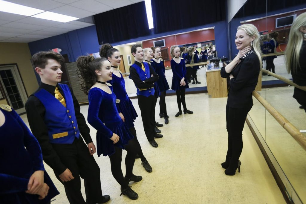Natalie O'Shea chatted with her dancers as they prepared for their Kickin' It Irish show .